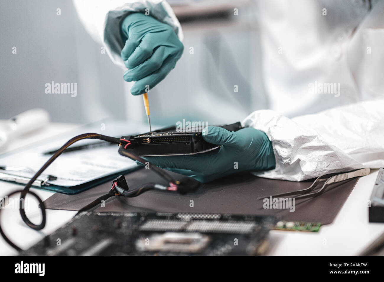 Digital Forensic Science Police Forensic Analyst Examining Computer Hard Drive Stock Photo Alamy