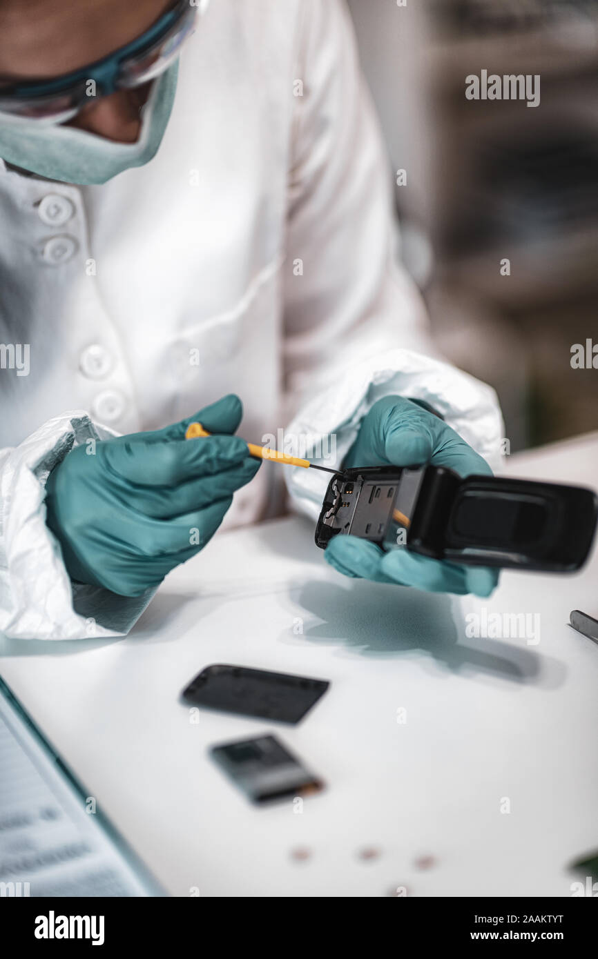 Digital Forensic Science Police Forensic Analyst Examining Confiscated Mobile Phone Stock Photo Alamy