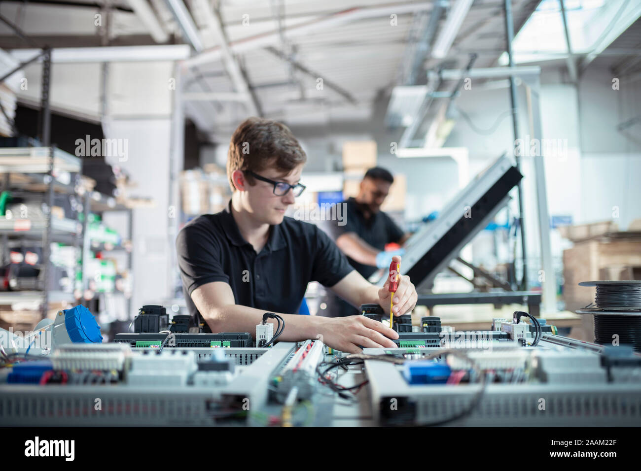 Apprentice electronics engineers in electronics assembly factory Stock Photo