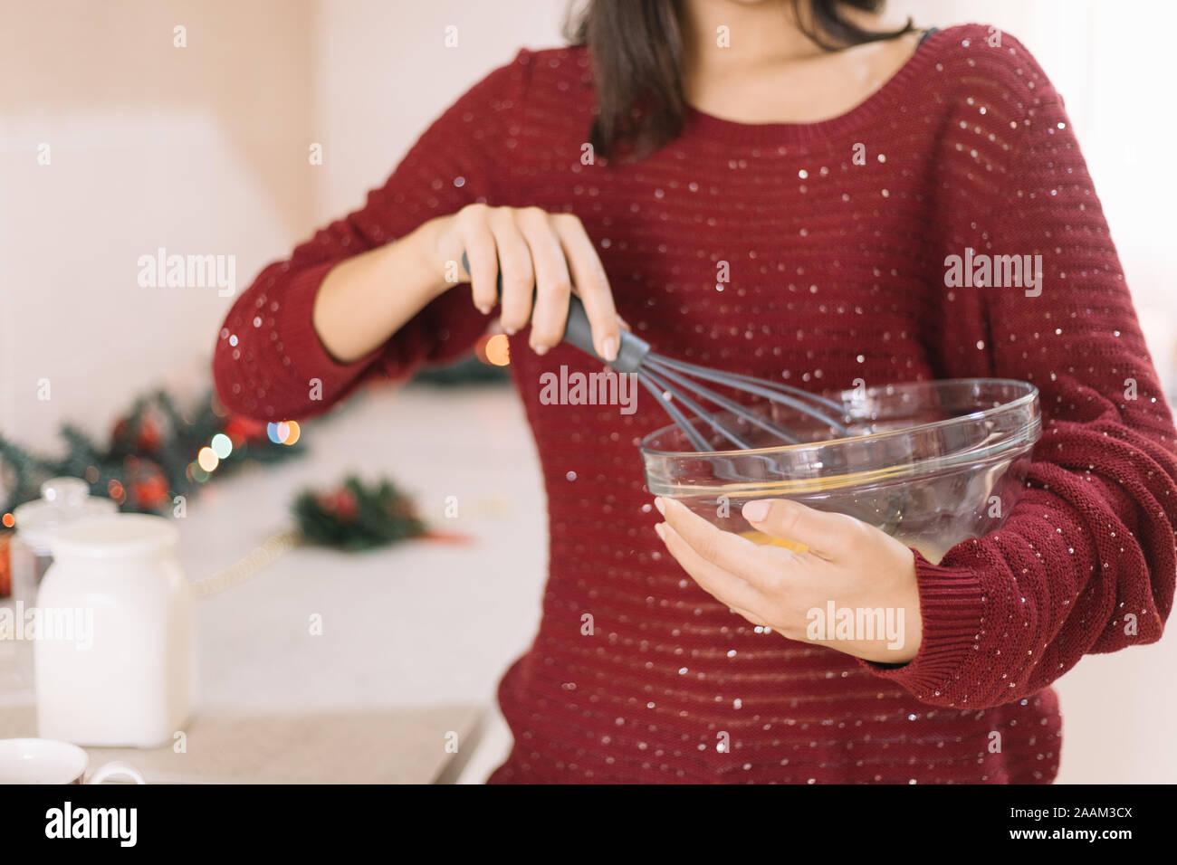Cropped woman holding bowl and whisking eggs Stock Photo