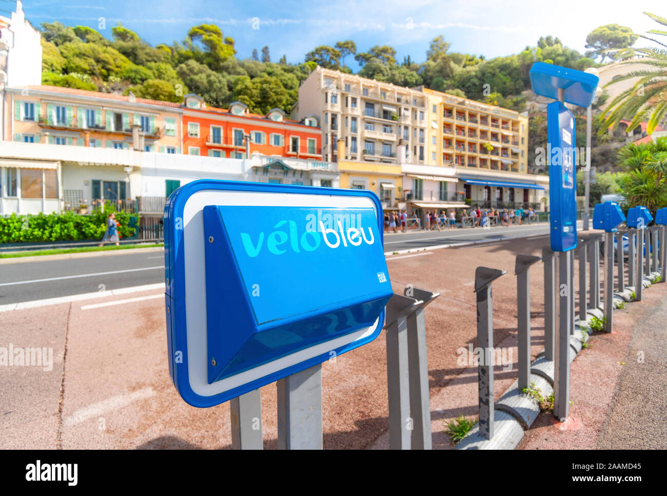 A Velo Bleu bicycle share stand sits empty on the Promenade des Anglais in the Mediterranean city of Nice, France. Stock Photo