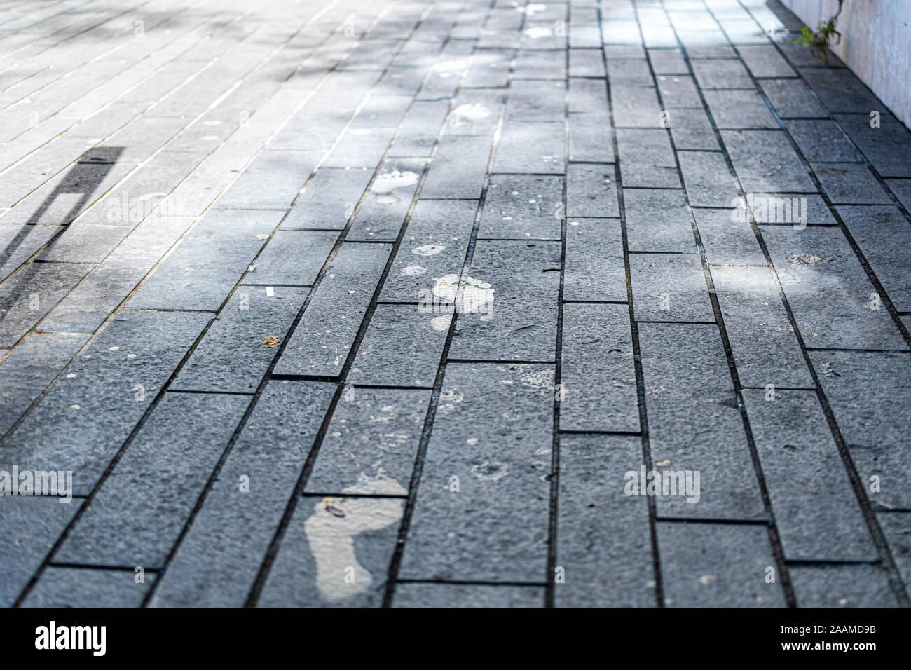 Wet footprints on concrete tiles. Stock Photo