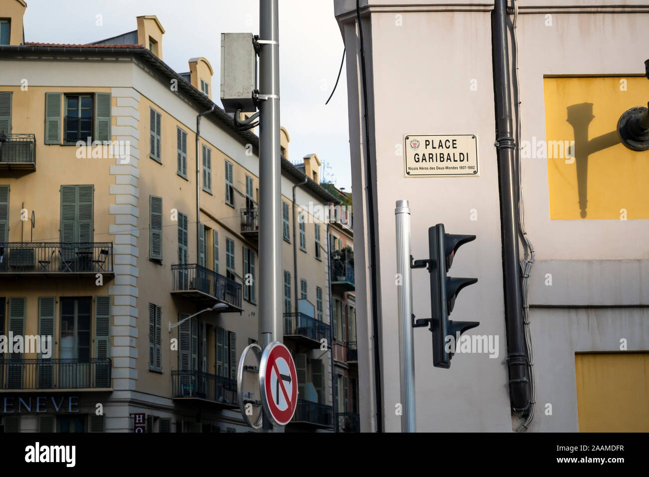 A street marker sign for the popular Place Garibaldi in the Old Town area of Nice, France. Stock Photo