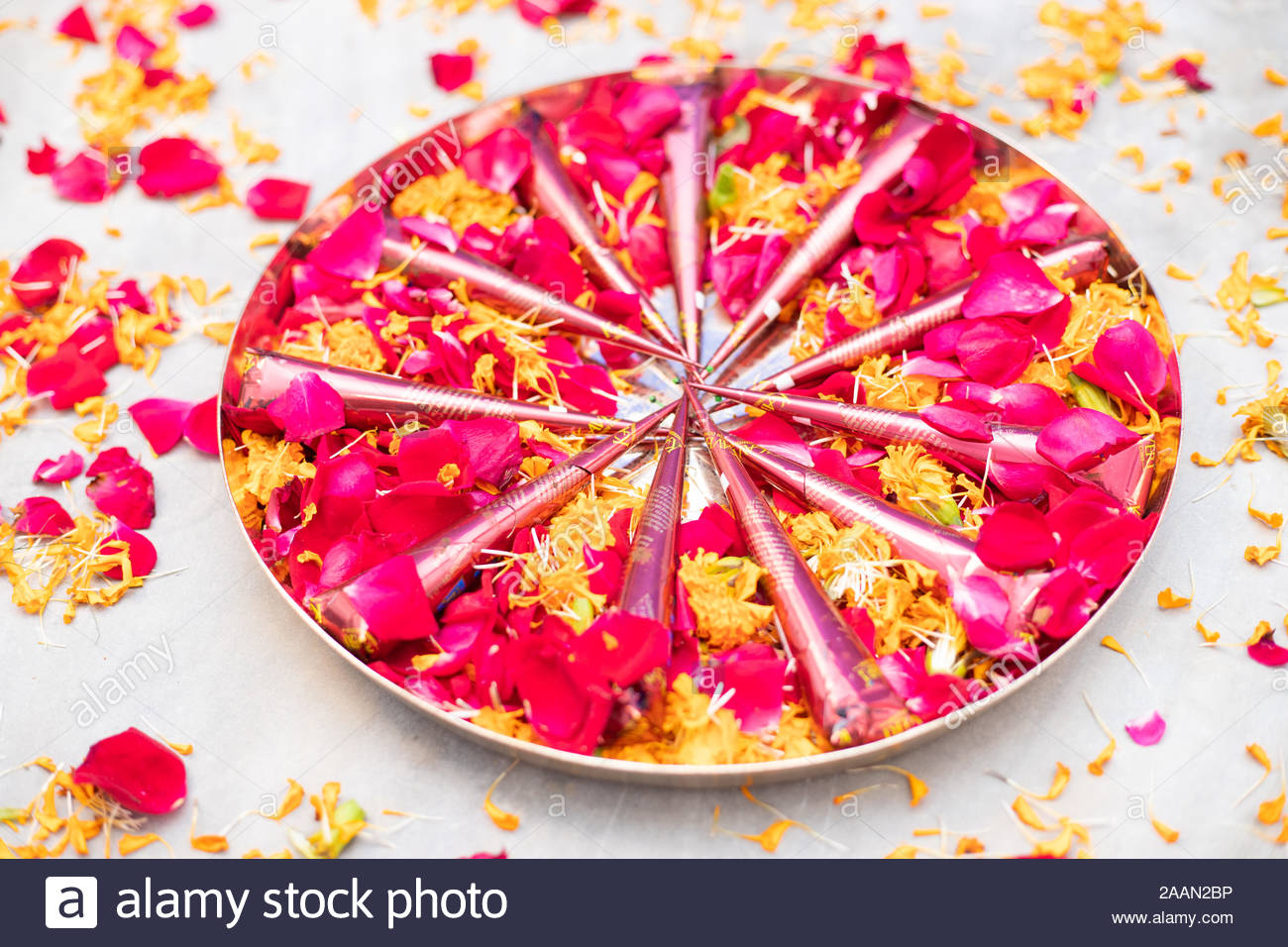 Traditionally decorated Henna or  mehendi plate decorated with rose flowers on the occasion of an Indian wedding Stock Photo