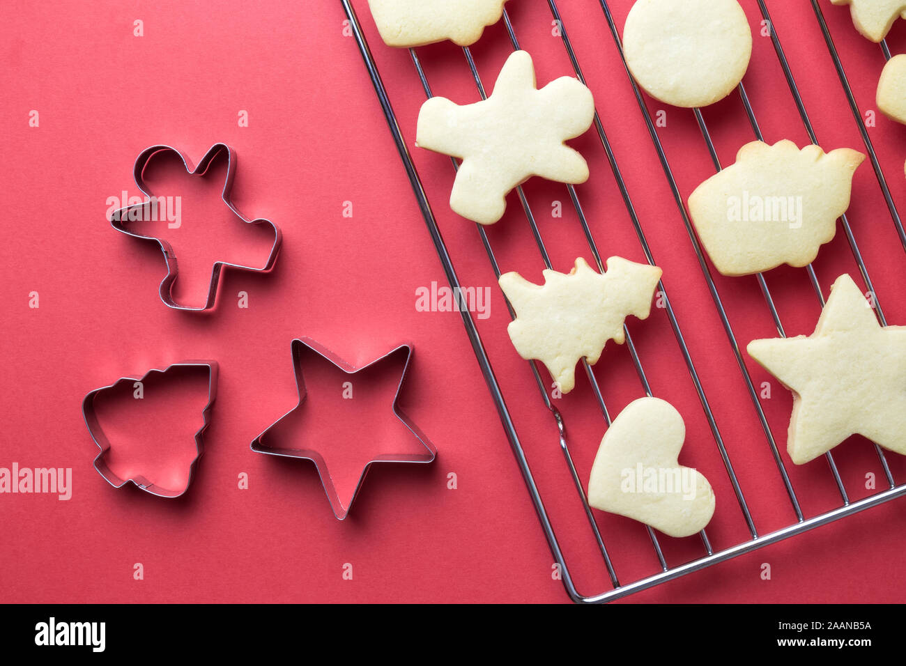 Flat Lay Of Christmas Cookies On Oven Grate And Cookie Cutters