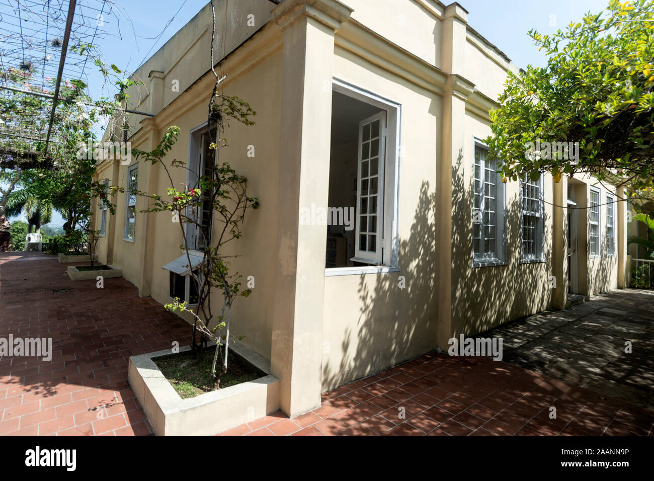 American author, Ernest Hemingway's corner bedroom with open window at his home, Finca La Vigia, in San Francisco de Paula, southeast of Havana city c Stock Photo