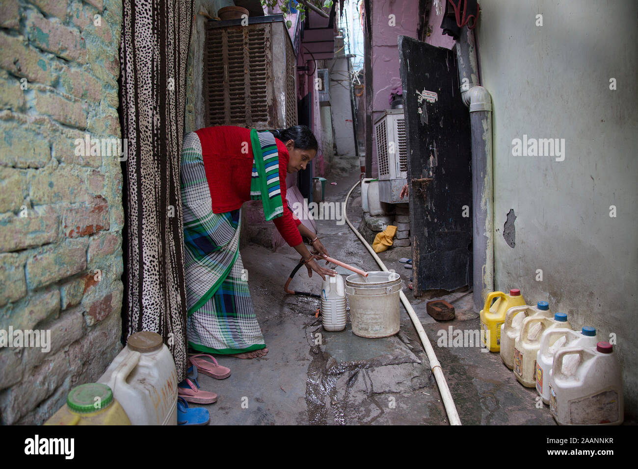 (191123) -- NEW DELHI, Nov. 23, 2019 (Xinhua) -- A woman fills a bucket with water from a tap in New Delhi, India, Nov. 23, 2019. Days after India's federal government rankings on tap water showed samples taken from the capital city Delhi have failed on all parameters, the local authorities Wednesday said it would collect over 3,000 fresh samples from across the city for quality check. The federal government's consumer affairs ministry last week said 11 drinking water samples drawn from various places in Delhi did not comply with the requirements of the Bureau of Indian Standard and failed o Stock Photo