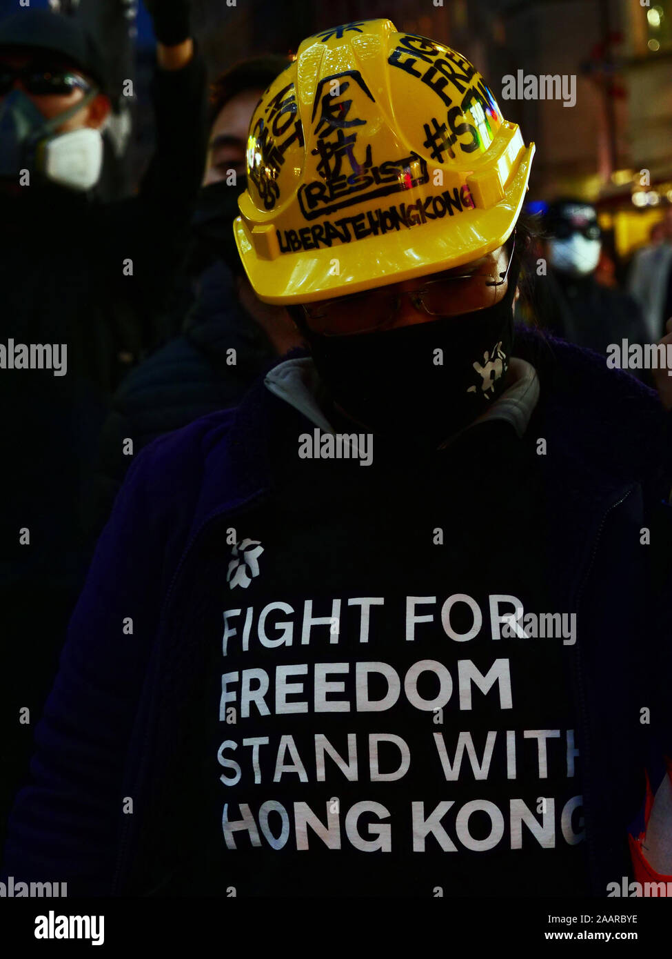London, UK. 23rd November. Supporters of the protests in Hong Kong demanding democracy and freedom seen on a demonstration in the West End of London, UK. Credit: Joe Kuis / Alamy News Stock Photo