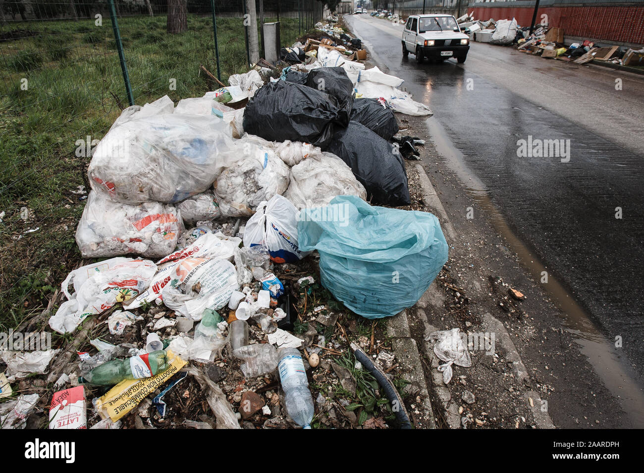 Caserta, Italy, February 21, 2008: Waste accumulates on a street in Caserta, Italy, north of Naples during the Naples waste management crisis in 2008. Stock Photo