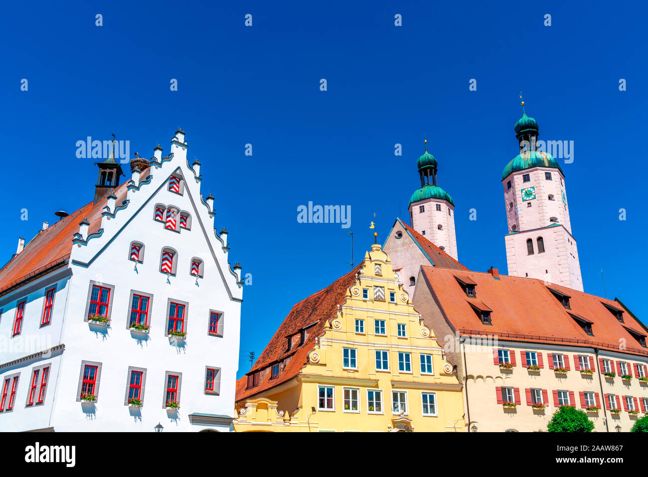 Low angle view of historic architecture and church against clear blue sky at Wemding, Bavaria, Germany Stock Photo