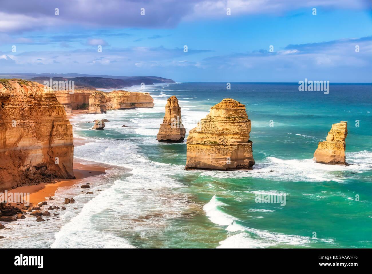 Stack rocks against sky at Twelve Apostles Marine National Park, Victoria, Australia Stock Photo