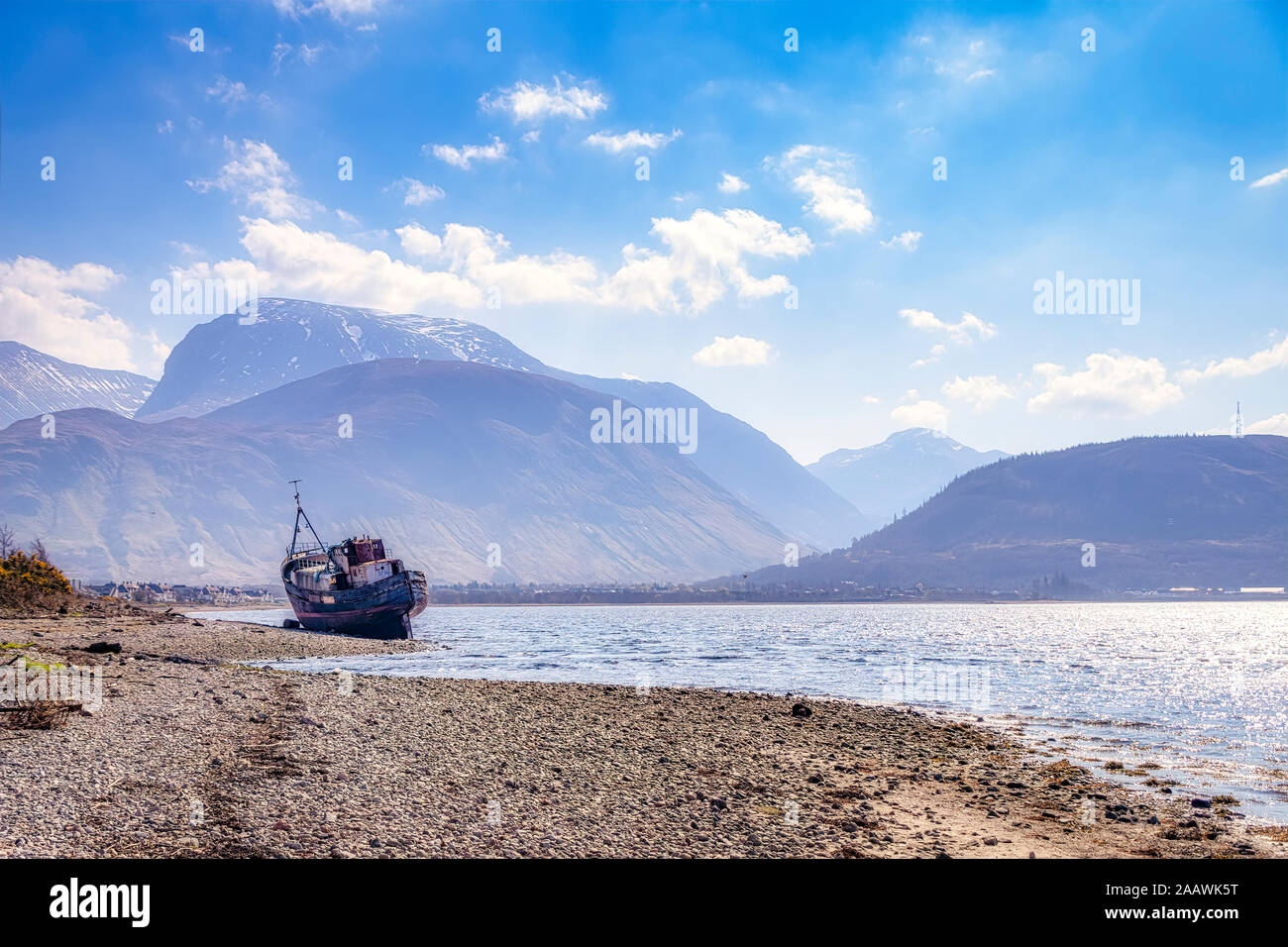 Shipwreck at Loch Linnhe with Ben Nevis and Fort William in background, Highlands, Scotland, UK Stock Photo