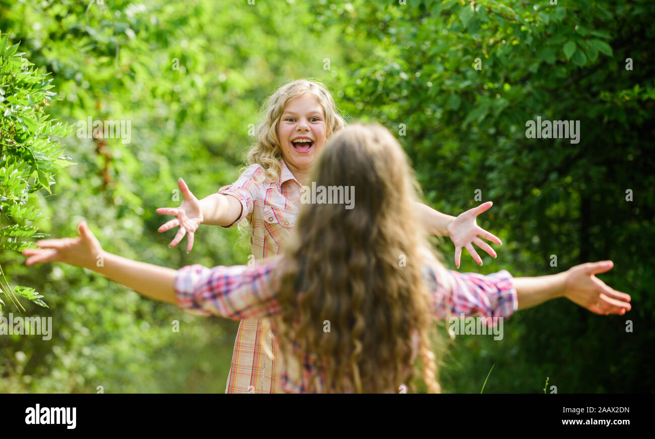 My dear friend. Happy girls excited see each other. Give me hug. Glad to meet you. Finally together. Happy reunion concept. Best friends forever. Happy kids running meet each other. Sincere emotions. Stock Photo