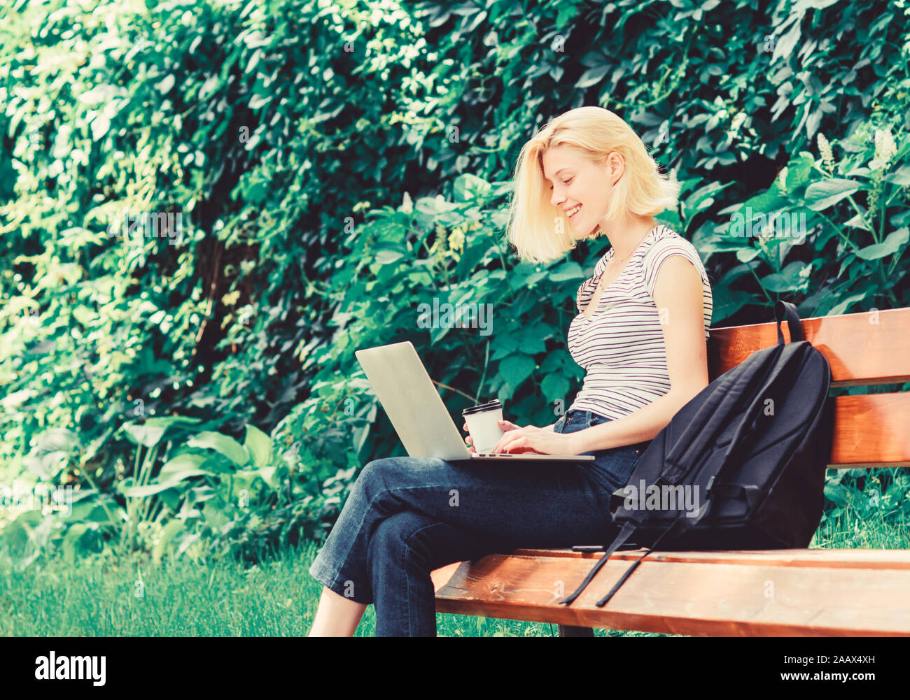 student girl study online. student prepare for exams. students life. Pretty woman. online education. modern woman student study online outdoor. happy woman work on laptop. Congratulations. Stock Photo