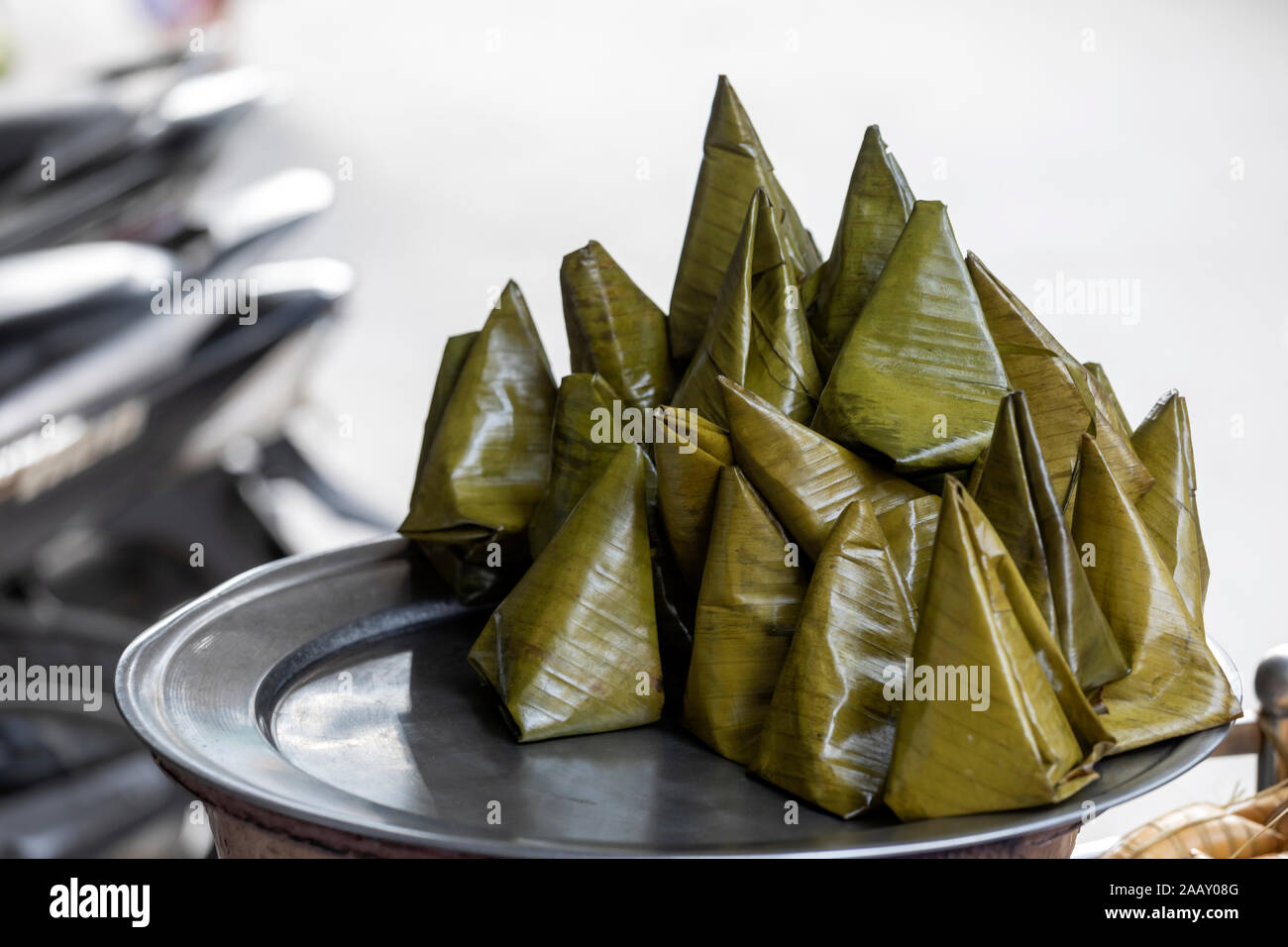 Banh It Is A Vietnamese Dumpling And Street Food In A Pyramid Shape Containing Rice And Mung Beans Cooked In Coconut Juice Wrapping Is A Banana Leaf Stock Photo Alamy