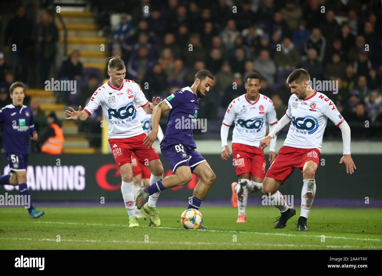 BRUSSELS, BELGIUM - NOVEMBER 24: Kemar Roofe of Anderlecht battles for the ball with Andriy Batsula of Kortrijk and Vladimir Kovacevic of Kv Kortrijk during the Jupiler Pro League match day 16 between RSC Anderlecht and KV Kortrijk on November 24, 2019 in Credit: Pro Shots/Alamy Live News Stock Photo
