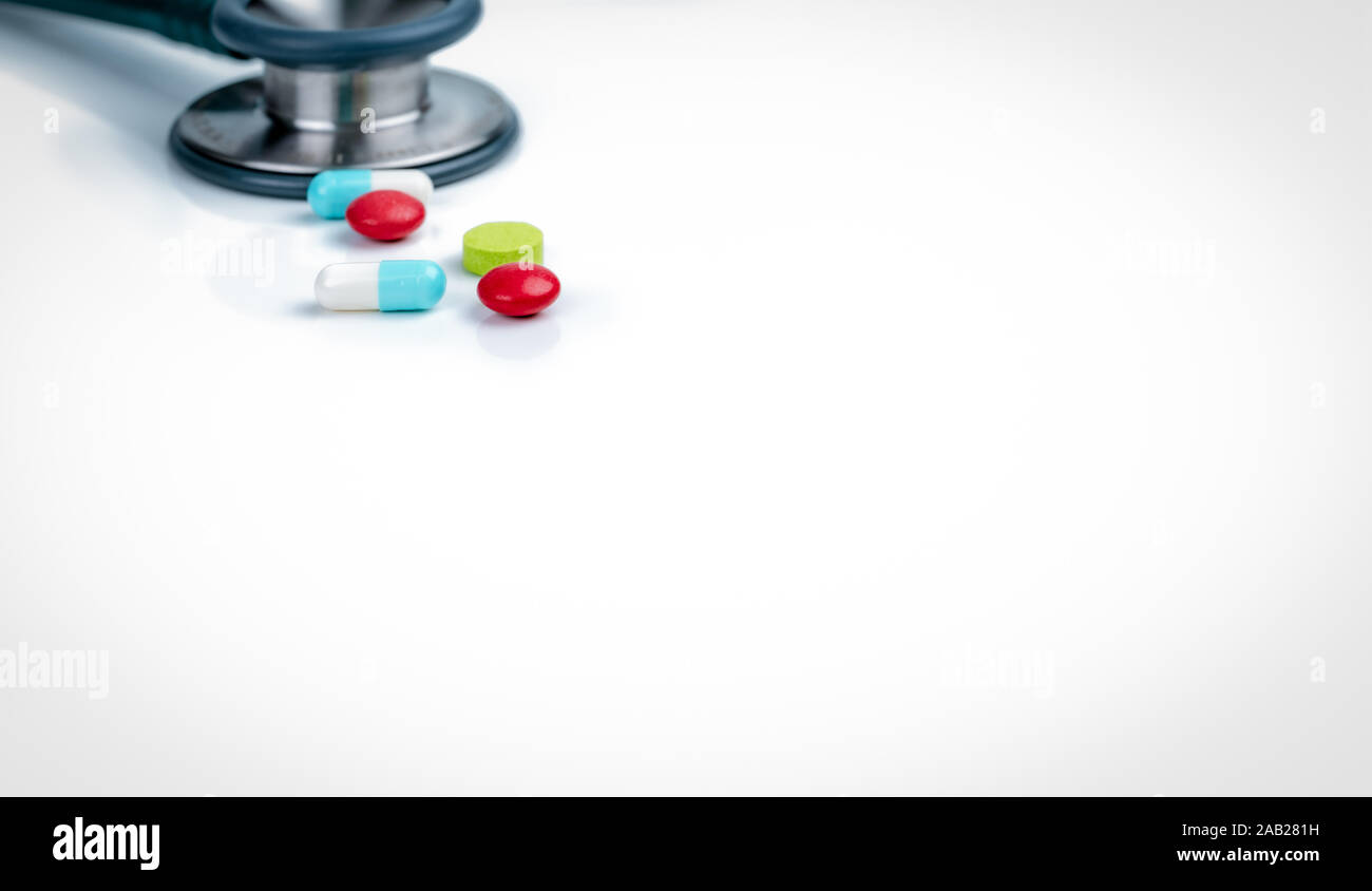 Stethoscope, capsule, and tablets pills on doctor table or nurse desk. Health checkup. Medical healthcare and medicine background. Physician tool for Stock Photo