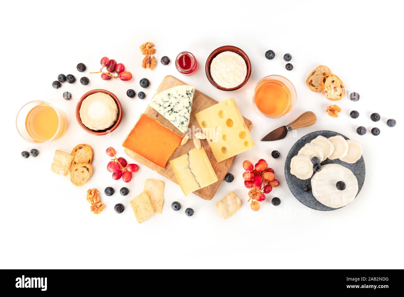 Cheese and wine, tasting and pairing, an overhead flat lay shot on a white background Stock Photo
