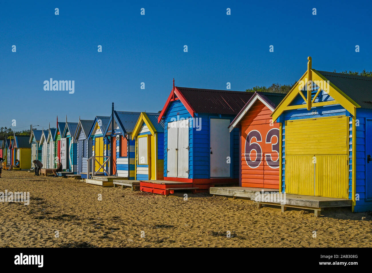 Australia, Victoria, Melbourne, April 12. 2019 - Brighton Beach features 82 colourful bathing boxes which are one of the tourist icons of Melbourne. B Stock Photo