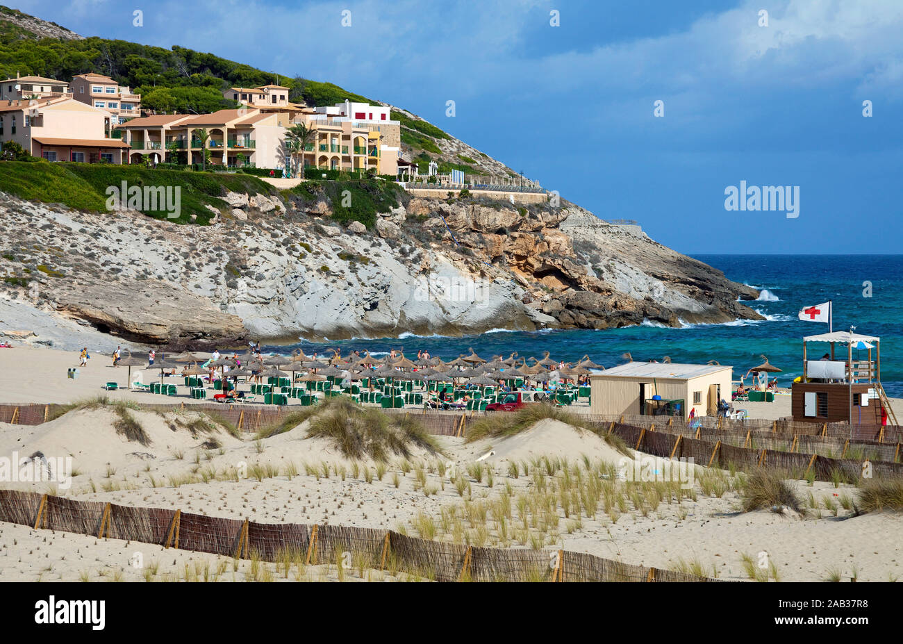 Protected area with dune grass, sourrounded by fence, conservation area at Cala Mesquida, Cala Ratjada, Mallorca, Balearic islands, Spain Stock Photo