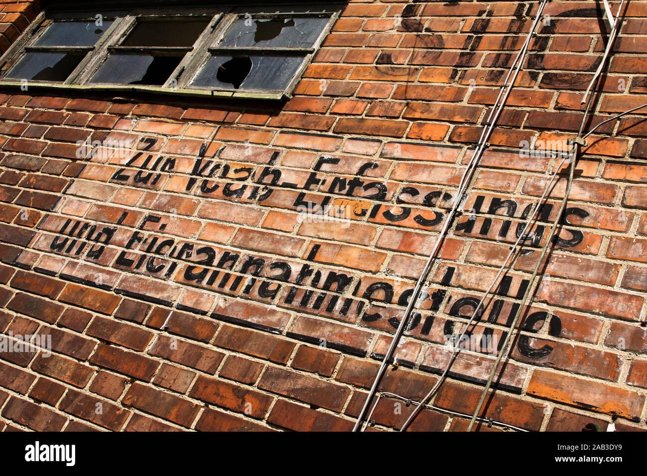 Beschriftung einer Außenwand von einem alten Silo im Hafen  Marking an outside wall of an old silo in the port  Stock Photo