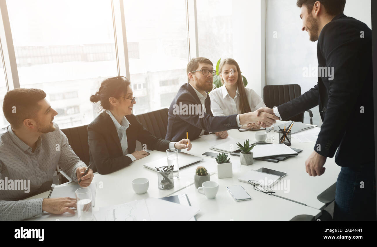 Members of commission congratulating applicant with job Stock Photo
