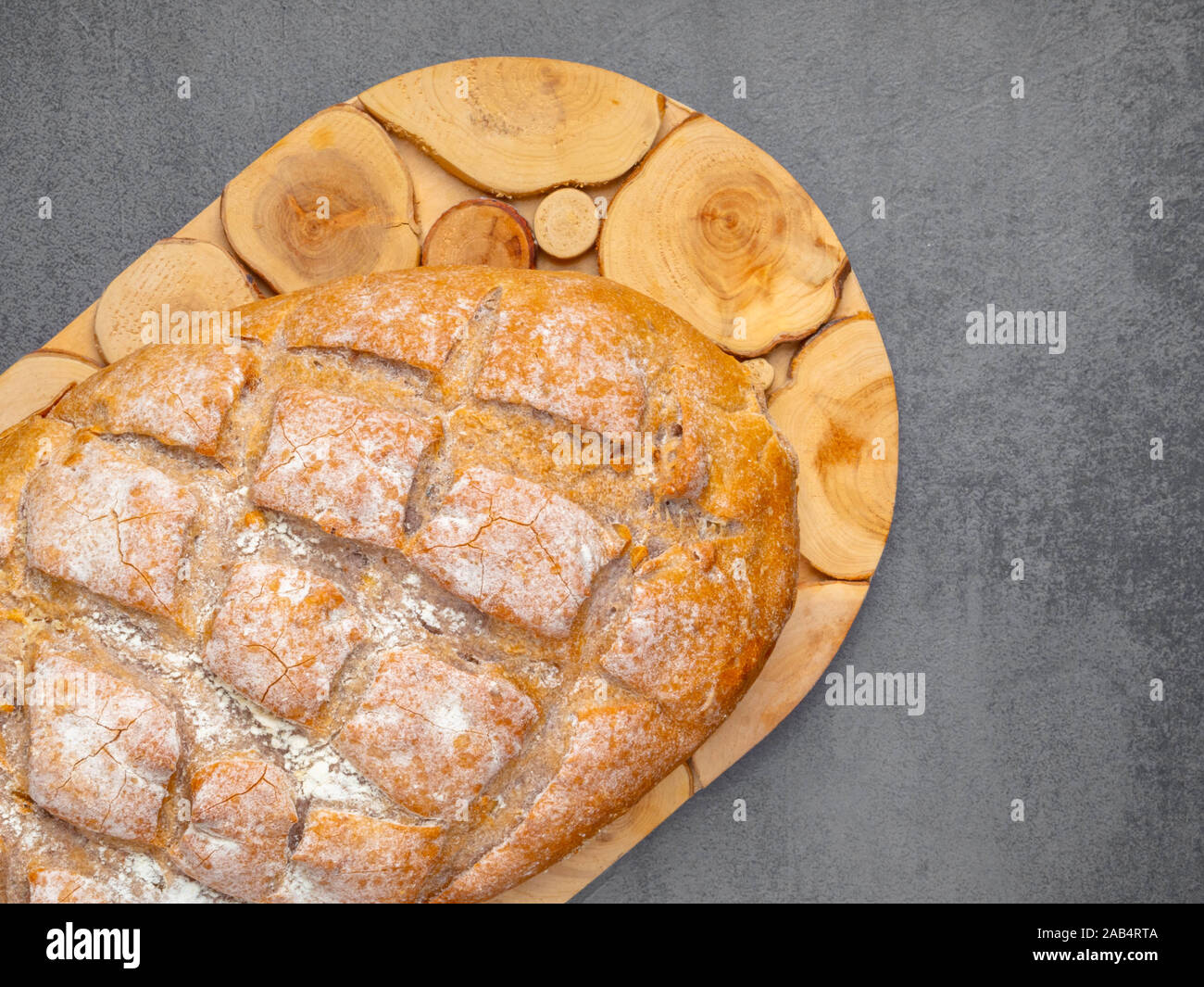 Bread on wood. Brown grain bread on wooden board. Bakery and grocery food concept Stock Photo