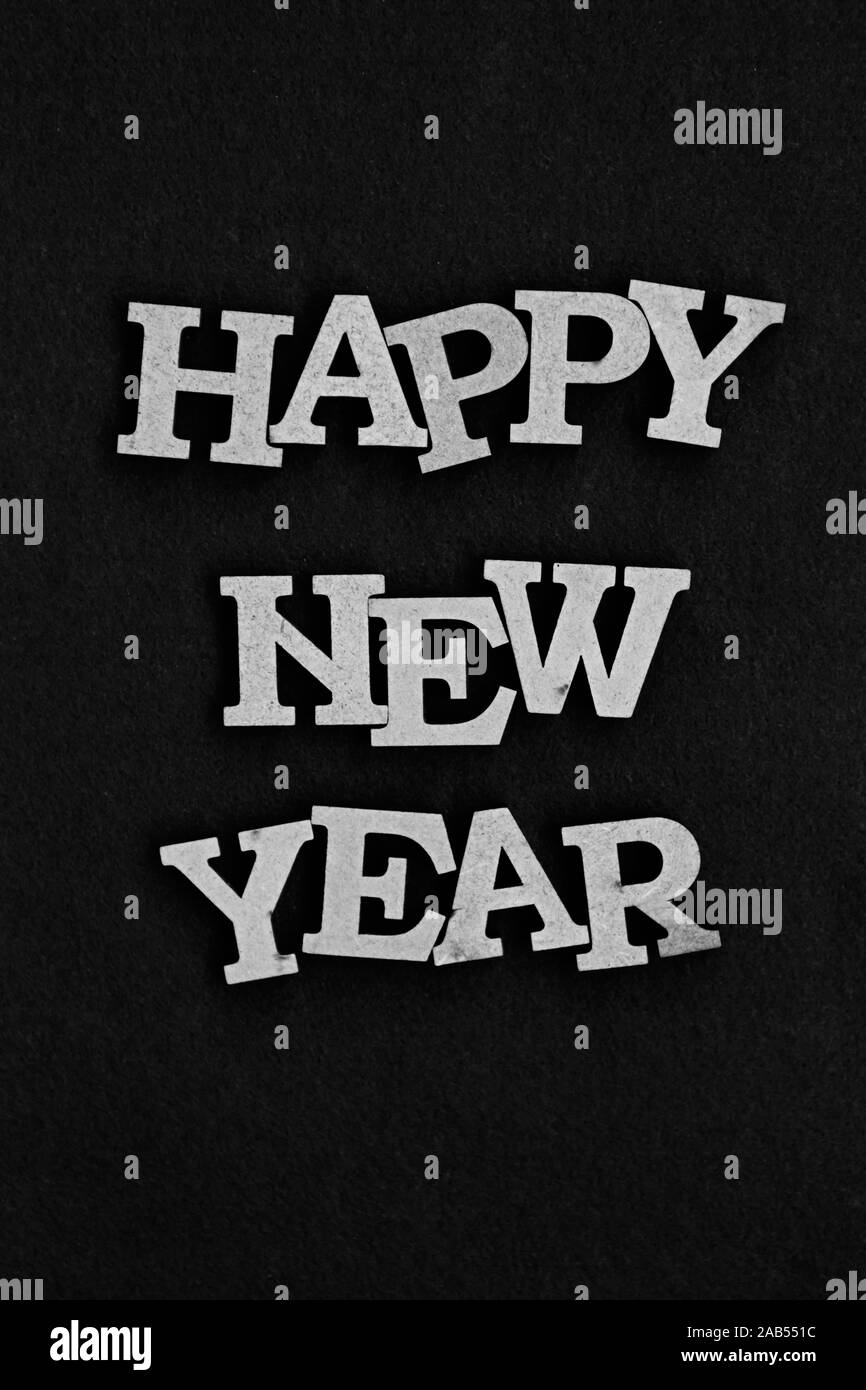 Happy New Year background edited with black and white film filter.Dark and contrast poster for winter holiday celebration Stock Photo