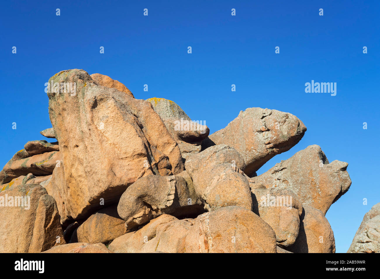 Strange rock formations and water / wind eroded boulders along the Côte de granit rose / Pink Granite Coast, Côtes d'Armor, Brittany, France Stock Photo