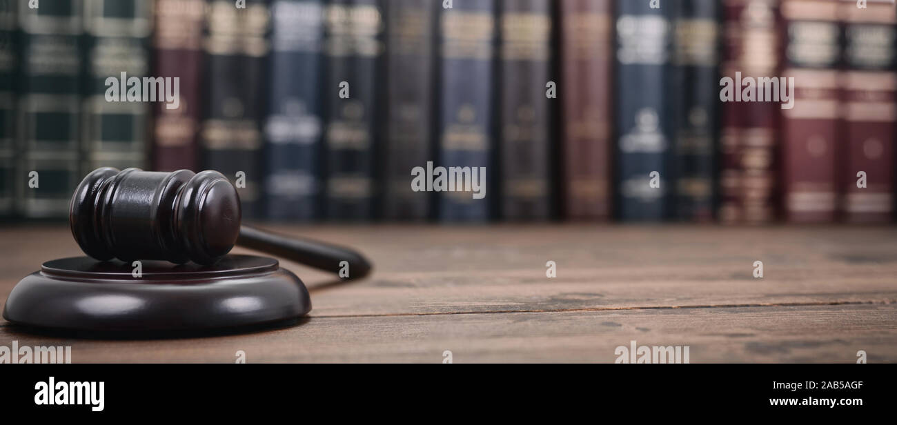 Law and Justice, Legality concept, Judge Gavel on a wooden background, Law library concept. Stock Photo
