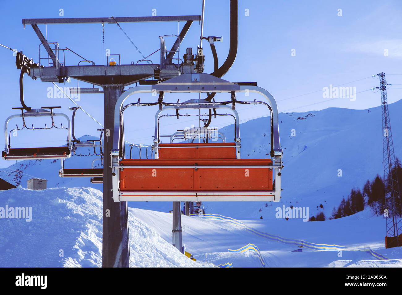 Chairlift or elevated passenger ropeway at ski area. Winter ski resort. Stock Photo