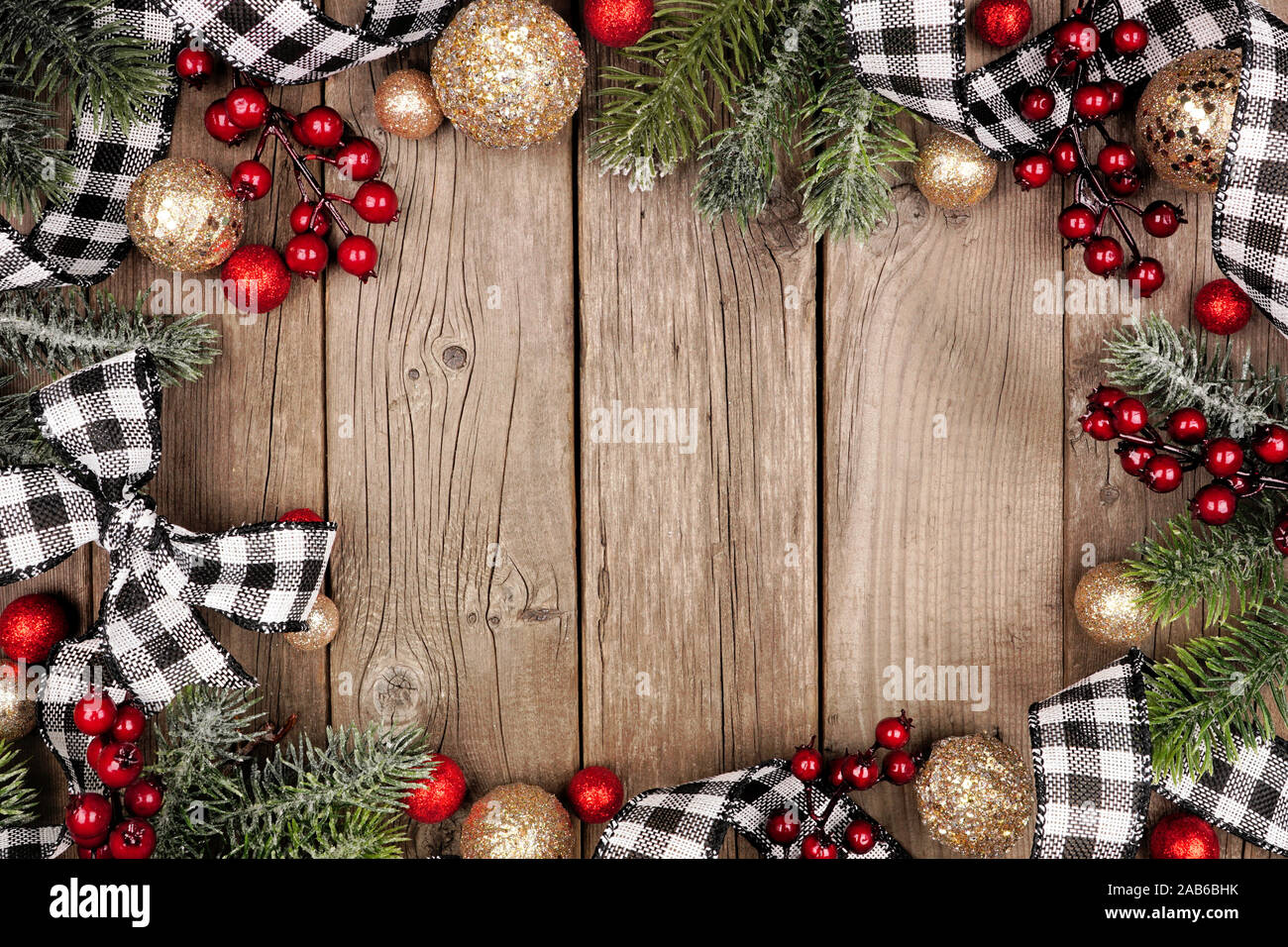 Christmas Frame With White And Black Checked Buffalo Plaid Ribbon Baubles And Tree Branches Top View On A Rustic Wood Background Stock Photo Alamy