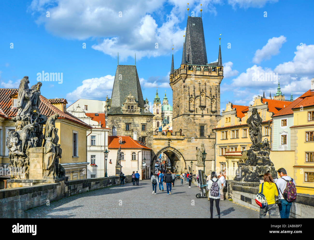 Tourists cross the Charles Bridge on the Path of the Kings leading to the lesser Tower on their way to Prague Castle. Stock Photo