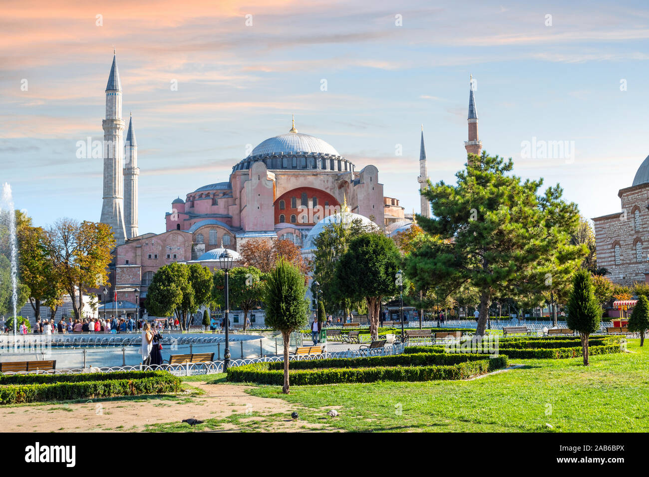 Tourists enjoy afternoon in Sultanahmet Square with the Hagia Sophia museum mosque in view in Istanbul, Turkey. Stock Photo