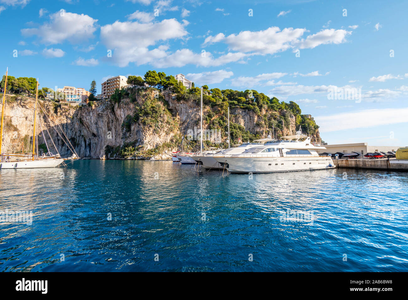 Sailboats and yachts moored in the Fontvieille Port along the Riviera in Monaco. Stock Photo