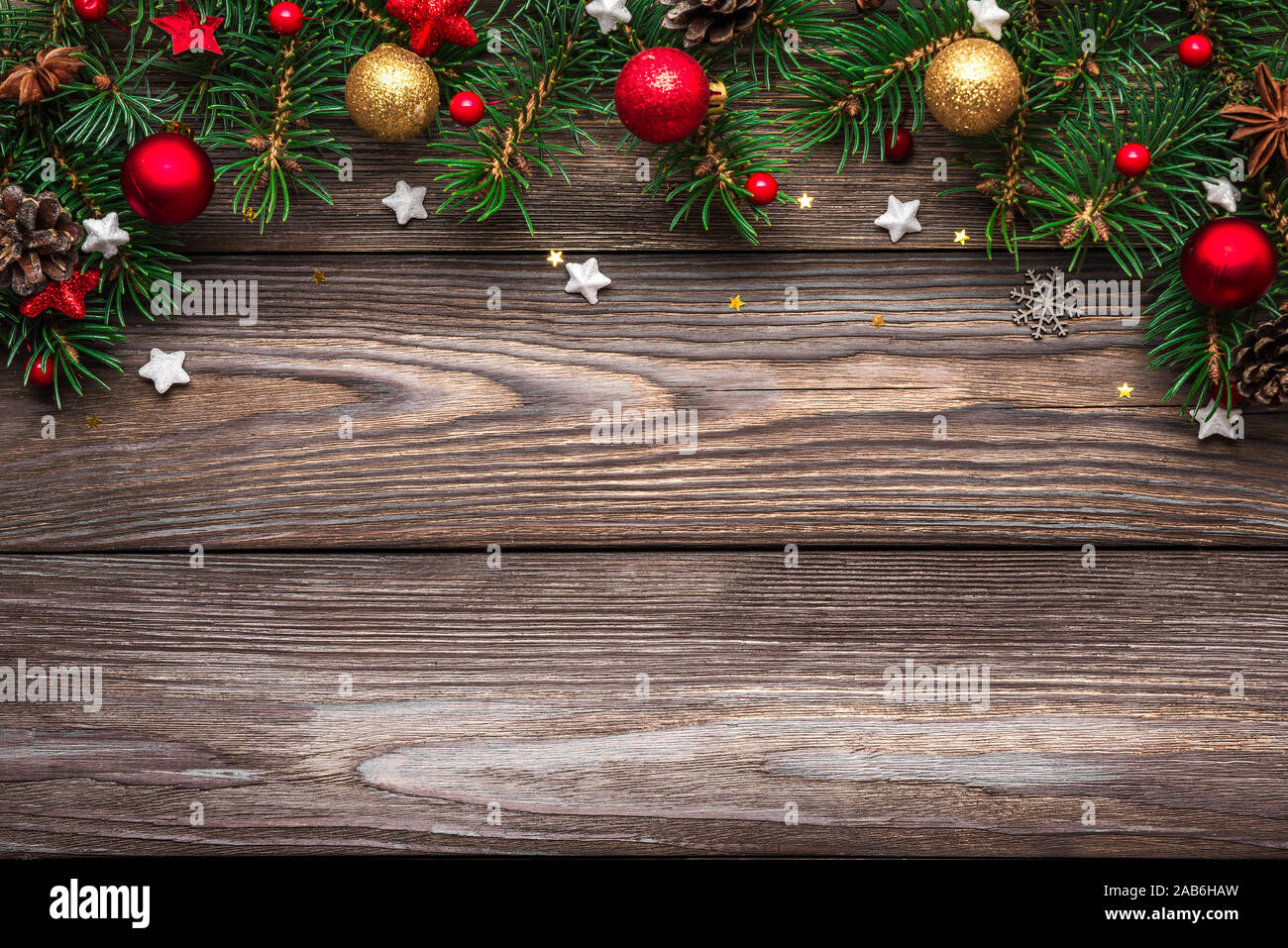 Christmas And Happy New Year Background Fir Tree Branches And Red With Gold Holiday Decorations On Rustic Wooden Table Top View Flat Lay With Copy Stock Photo Alamy