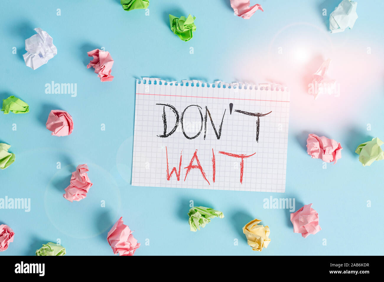 Word writing text Don T Wait. Business photo showcasing Take action now and do something for a purpose Act quickly Colored crumpled rectangle shaped r Stock Photo