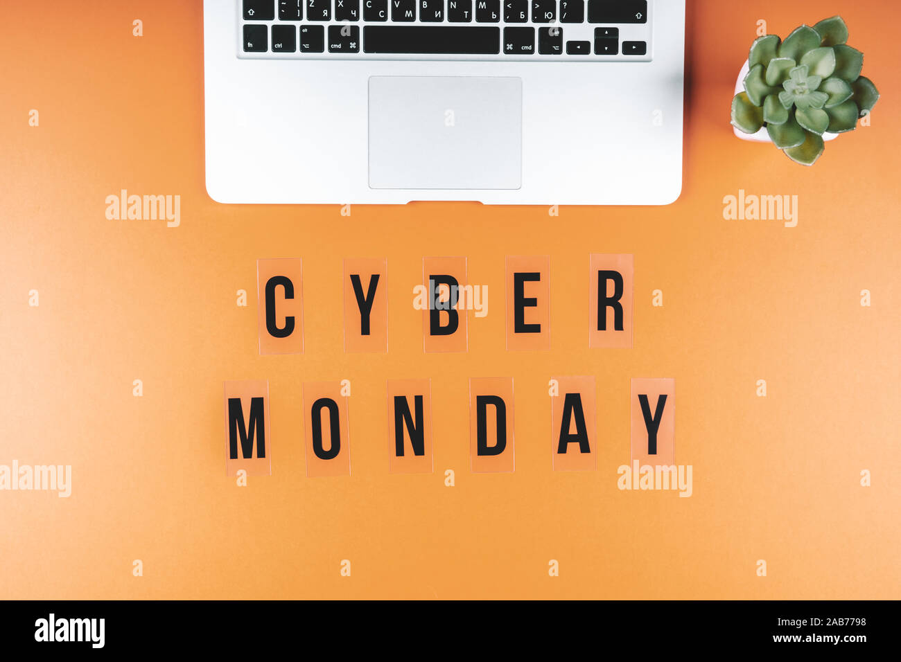 The Words Cyber Monday On A Bright Orange Background With A Laptop Stock Photo Alamy