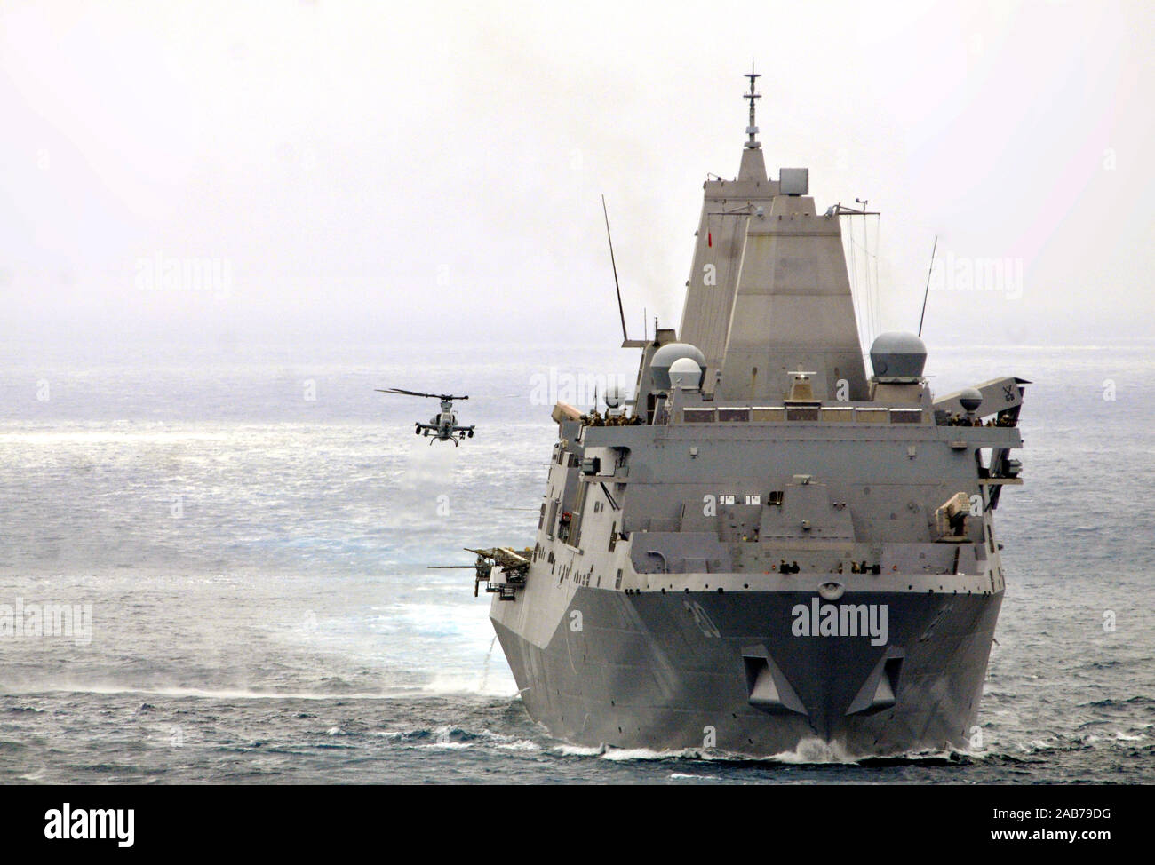 "(July 21, 2012) An AH-1Z Viper helicopter assigned to the ""Purple Foxes"" of Marine Medium Helicopter Squadron 364 (Reinforced), approaches the amphibious transport dock ship USS Green Bay (LPD 20) during a composite unit training exercise (COMPTUEX). Stock Photo"