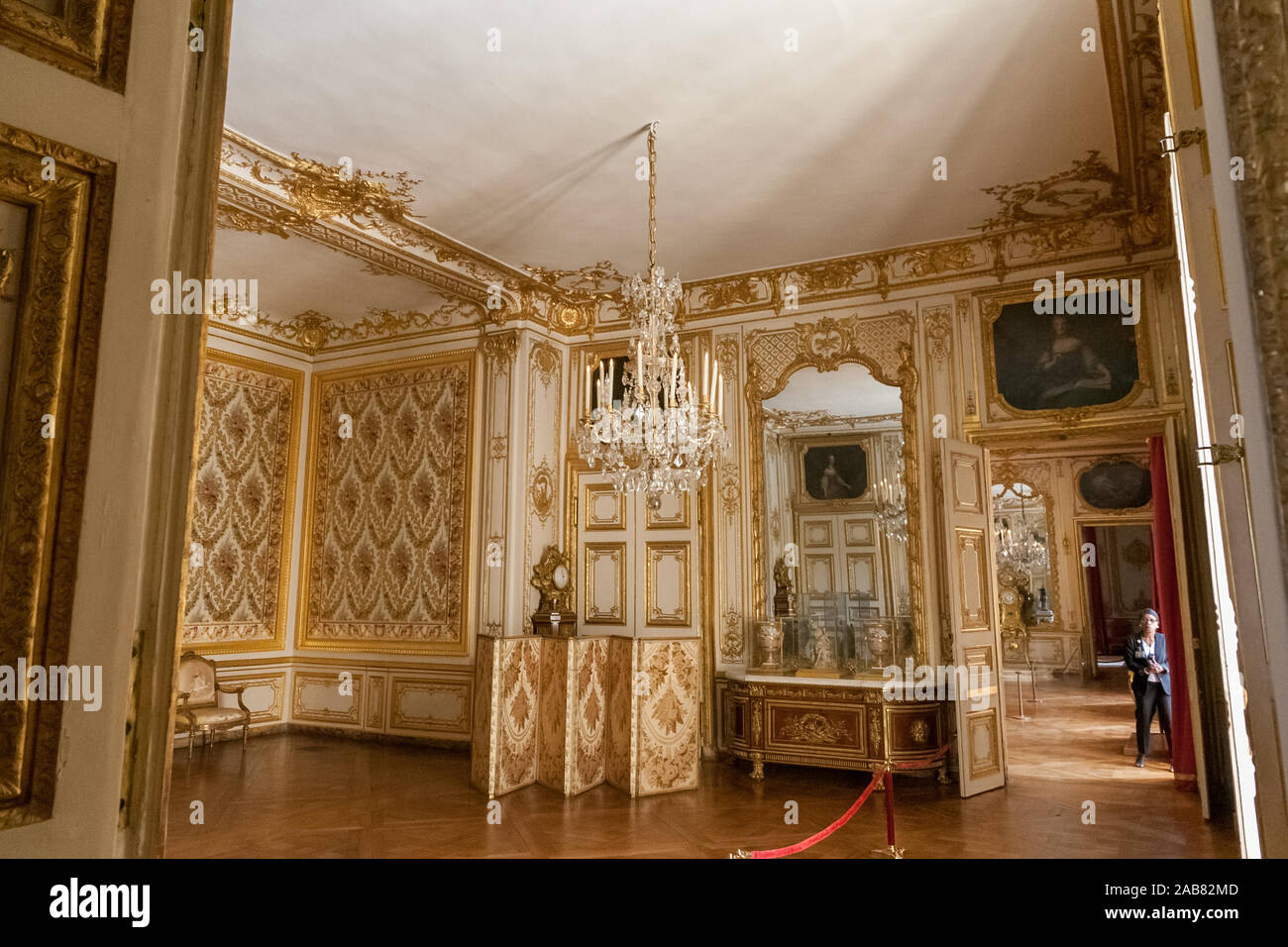 Glancing into Louis XV's bedchamber with the alcove on the left in the King's private apartment in the famous Palace of Versailles. It can be visited... Stock Photo