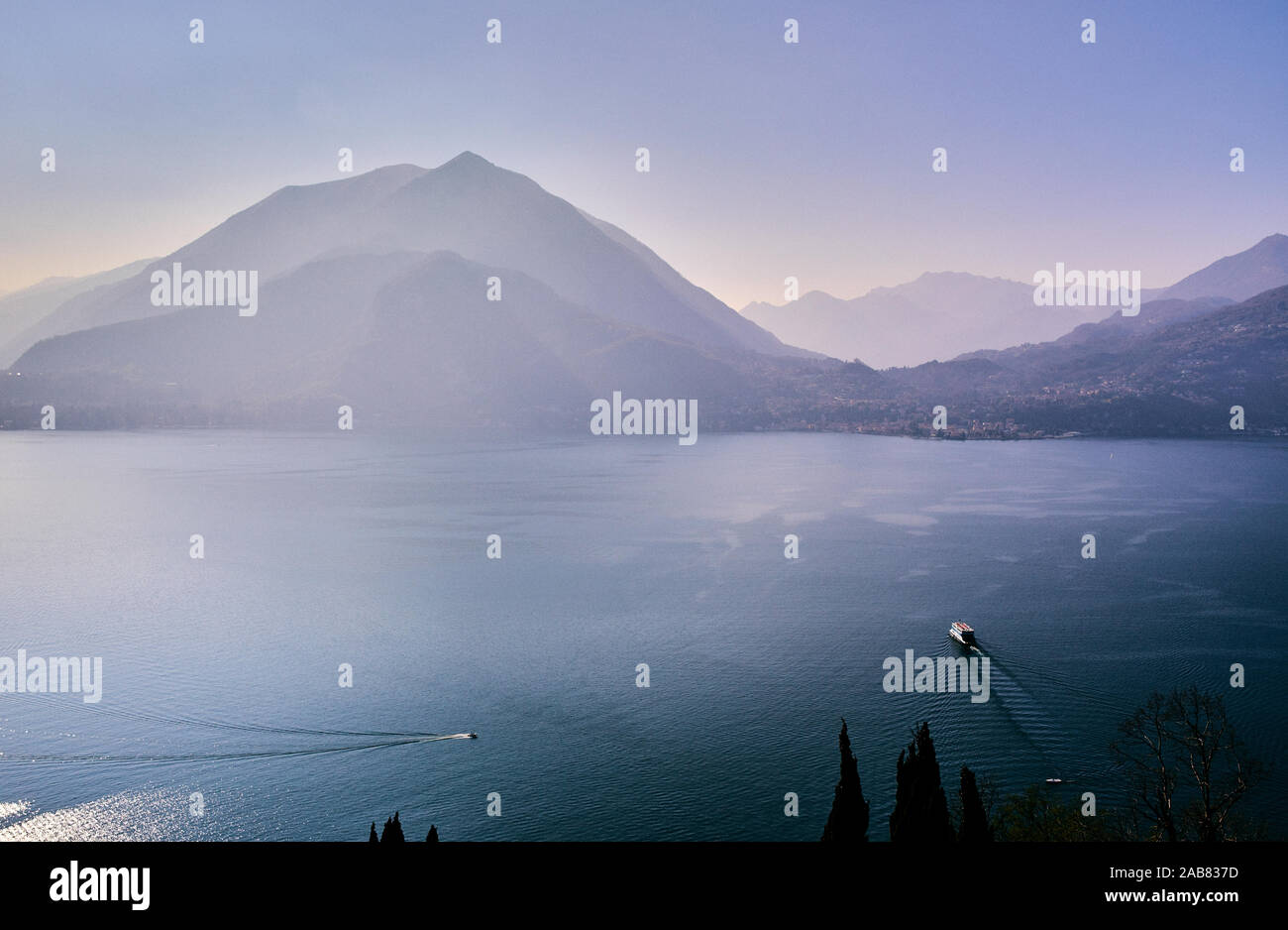 High angle view of Lake Como with a ferry boat travelling across the lake, Lombardy, Italian Lakes, Italy, Europe Stock Photo