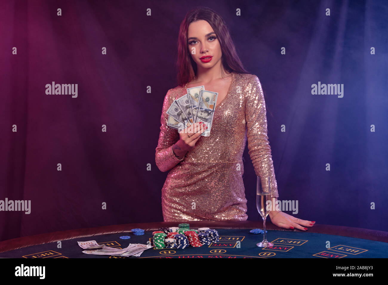 Girl Playing Poker At Casino Holding Money Posing At Table With Chips Champagne Cash On It Black Smoke Background Close Up Stock Photo Alamy