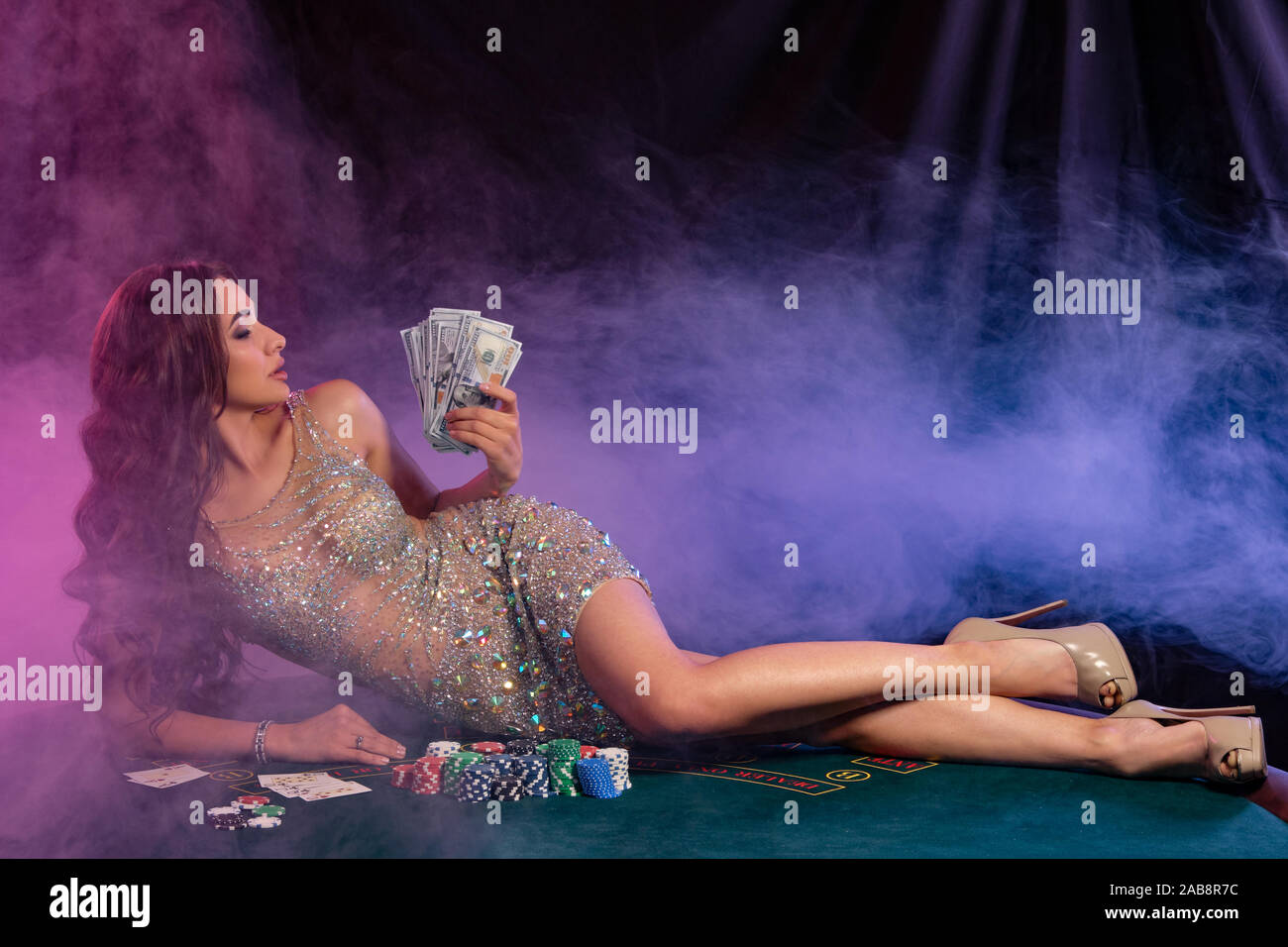 Girl In Golden Dress Playing Poker At Casino Holding Cash Laying On Table With Chips Cards On It Black Smoke Background Gambling Close Up Stock Photo Alamy