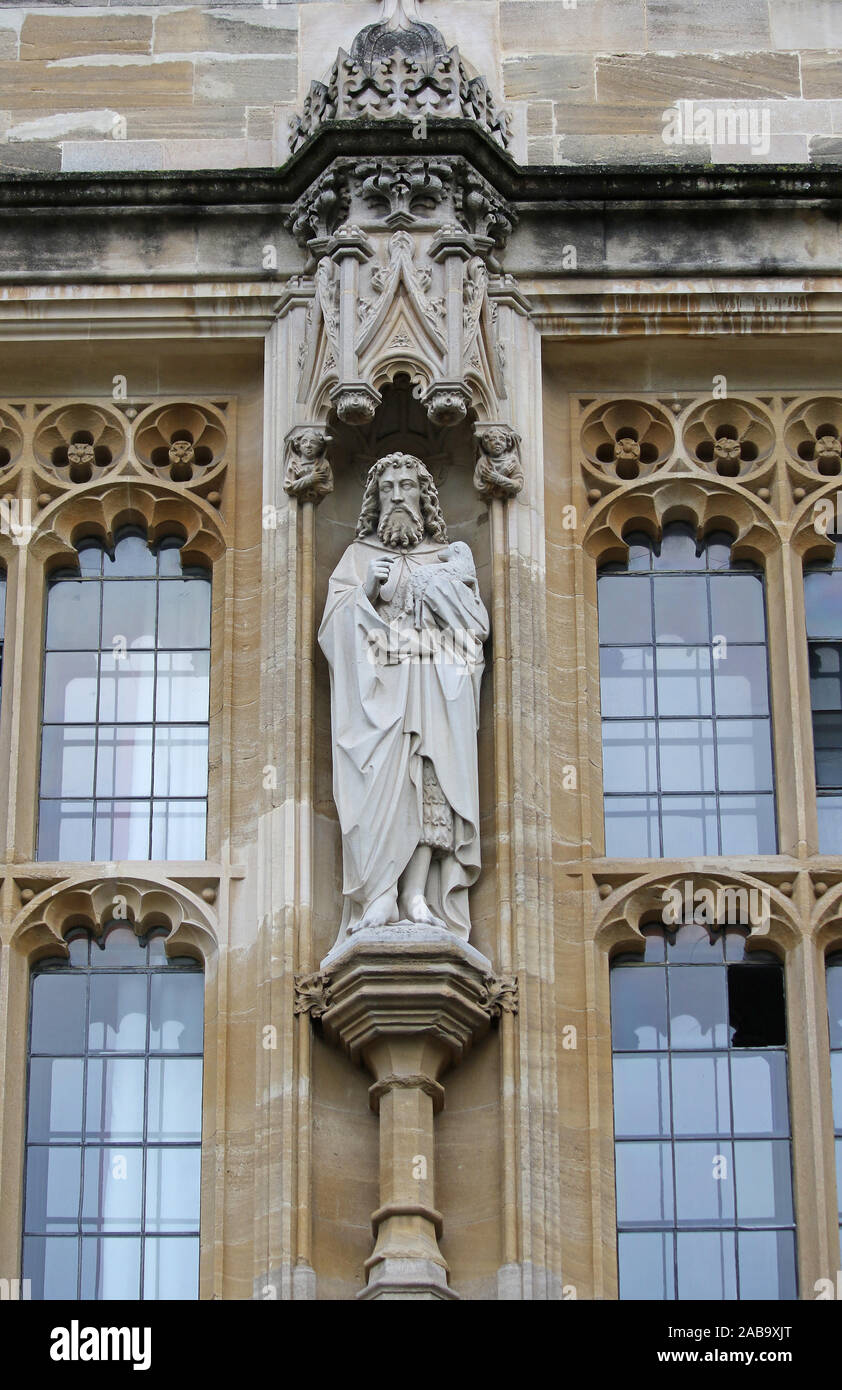 statue of St John the Baptist by Eric Gill in the front quad in the gate tower of St John's College Oxford part of the University Stock Photo