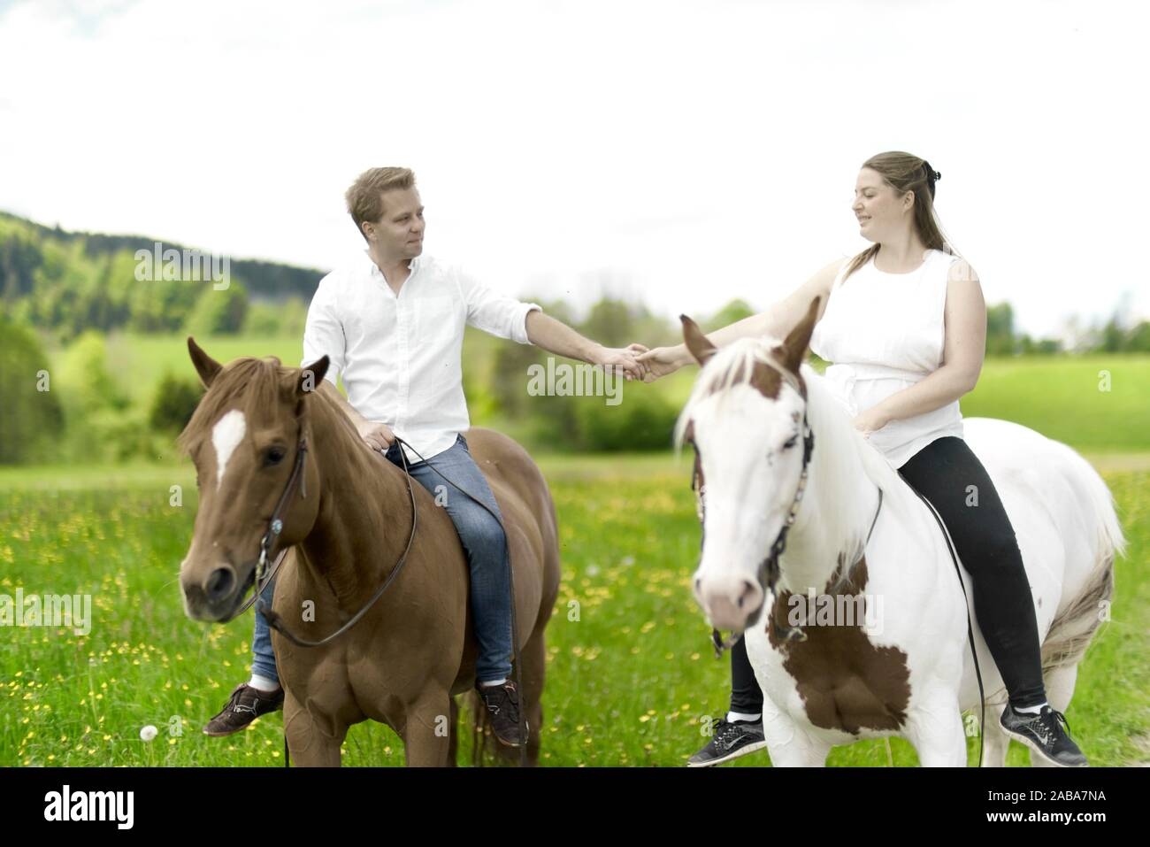 Page 2 Couple Riding Horses High Resolution Stock Photography And Images Alamy