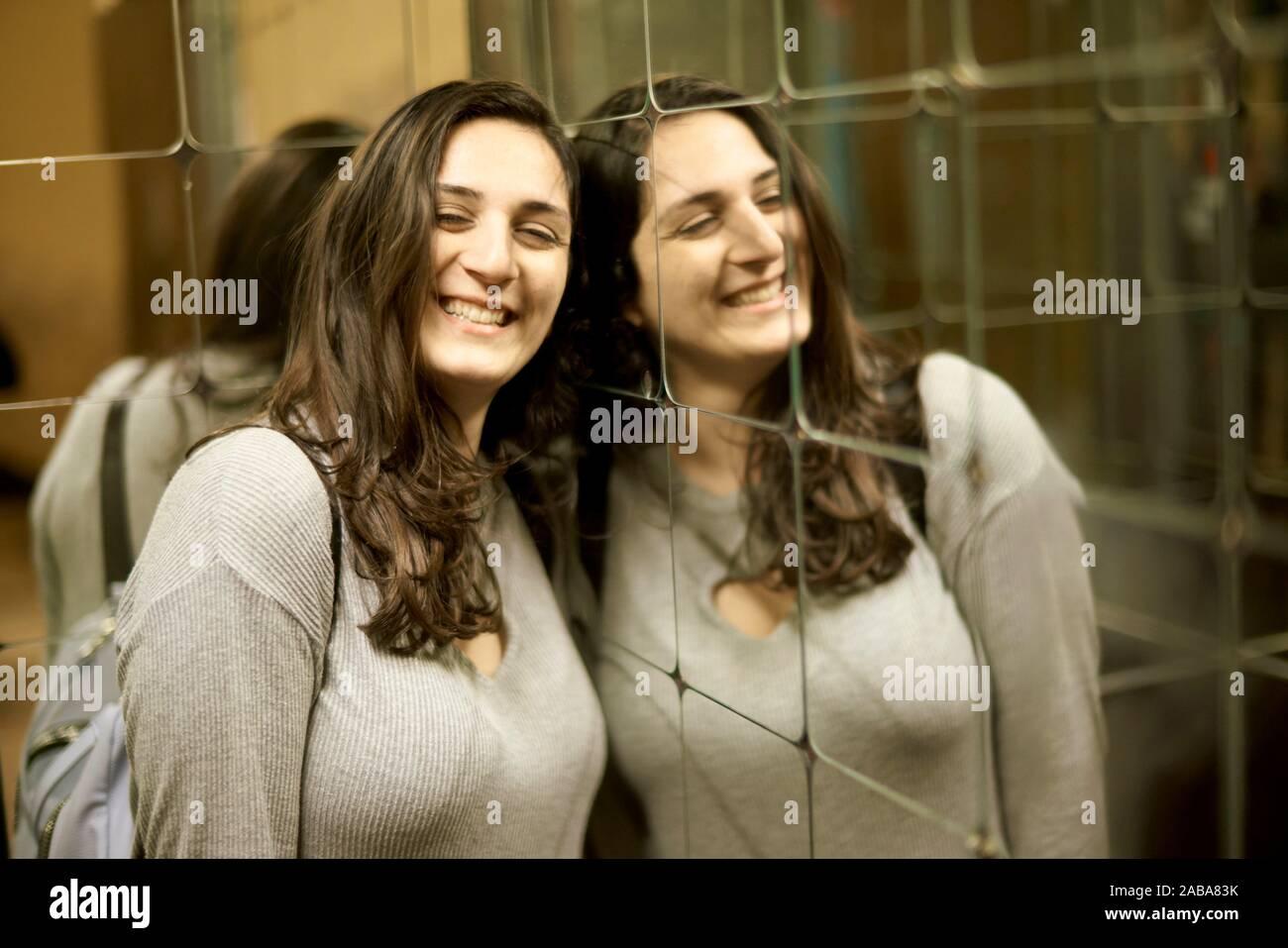 Happy woman beside mirror Stock Photo