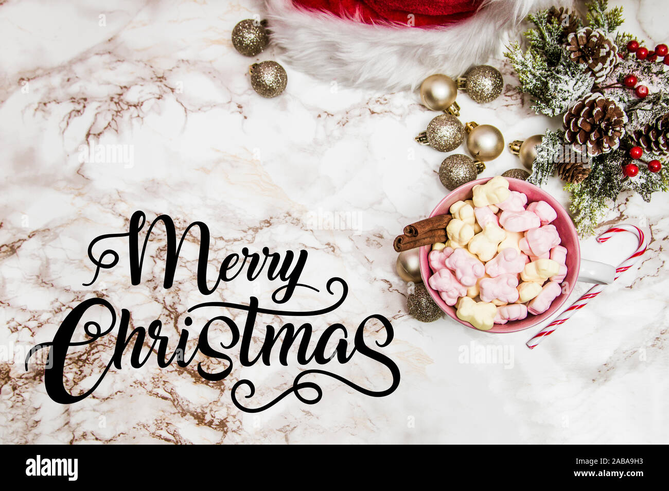 Pink White Mug With Marshmallows Christmas Tree Ornaments And Santa Claus Hat On A Marble And Pink Background With The Quote Merry Christmas Stock Photo Alamy