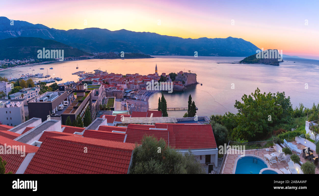 Panoramic view over Old Town of Montenegrin town Budva on the Adriatic Sea at sunrise, Montenegro Stock Photo
