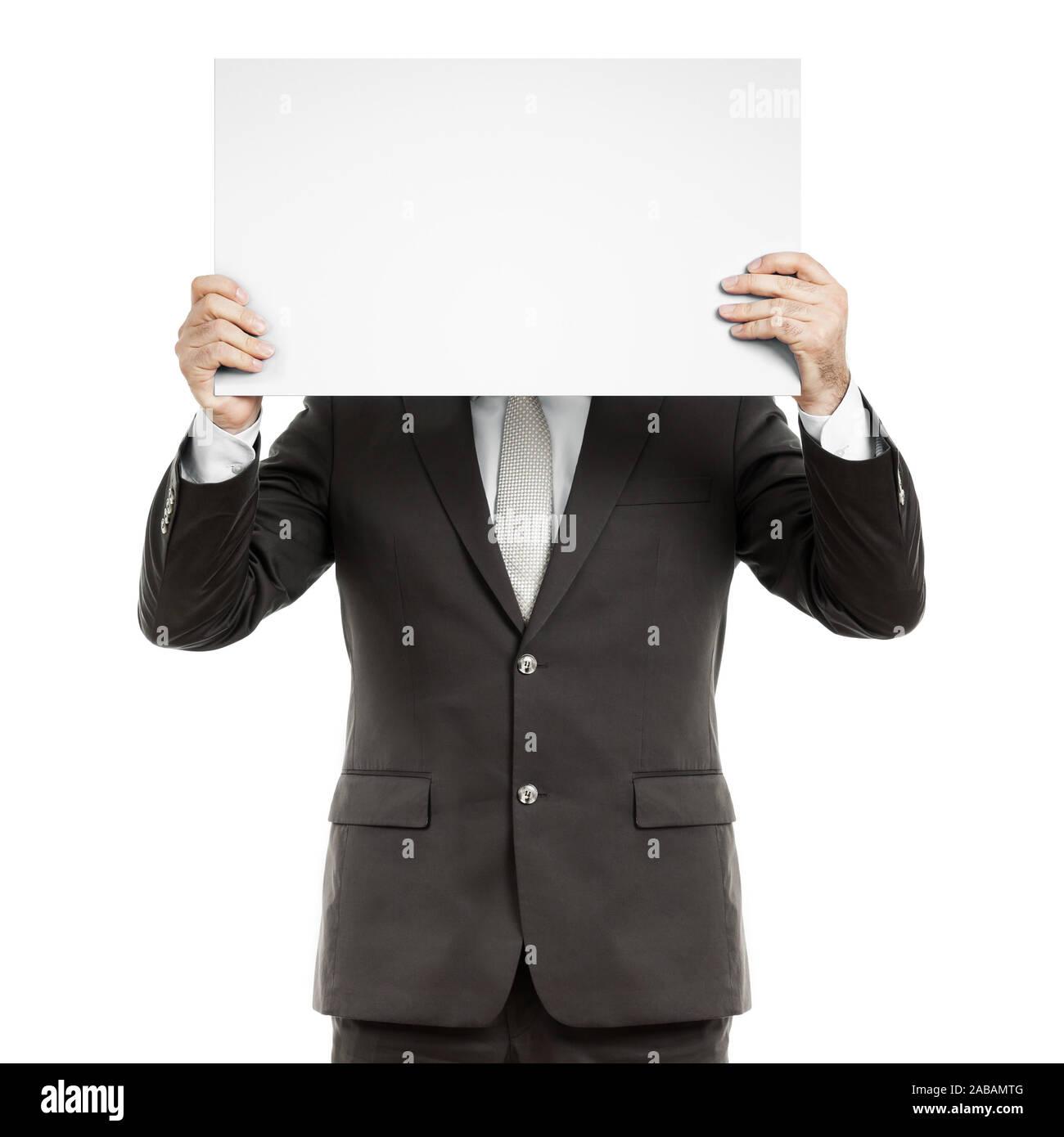 Ein Geschaeftsmann, der ein unbeschriebenes Schild in der Hand haelt Stock Photo