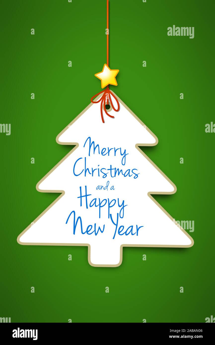 Ein dekorativer Weihnachtsbaum vor gruenem Hintergrund Stock Photo